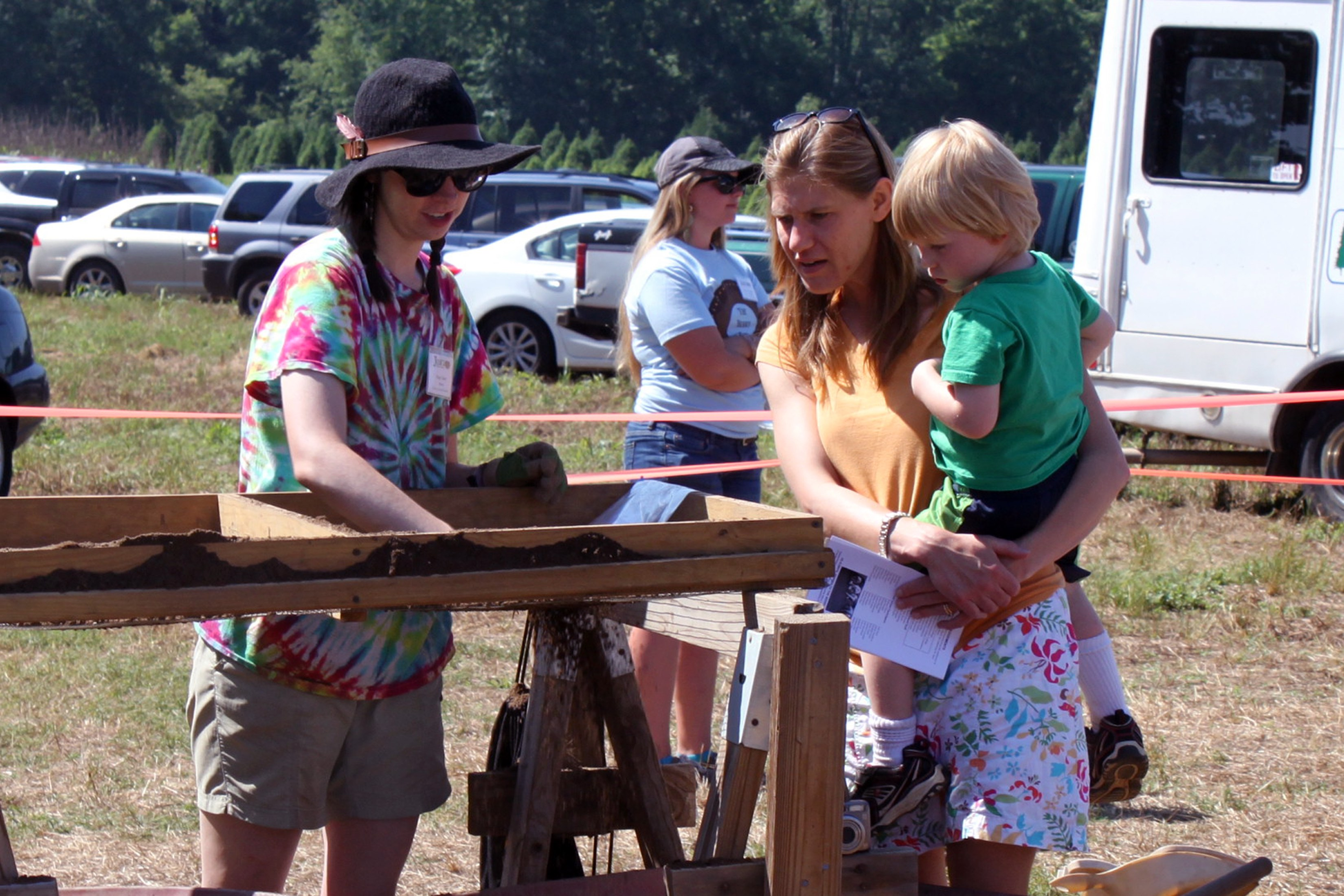 Visitors learn how to sift for artifacts at the annual Public Archaeology Day. (photo by Beth Lawrence)