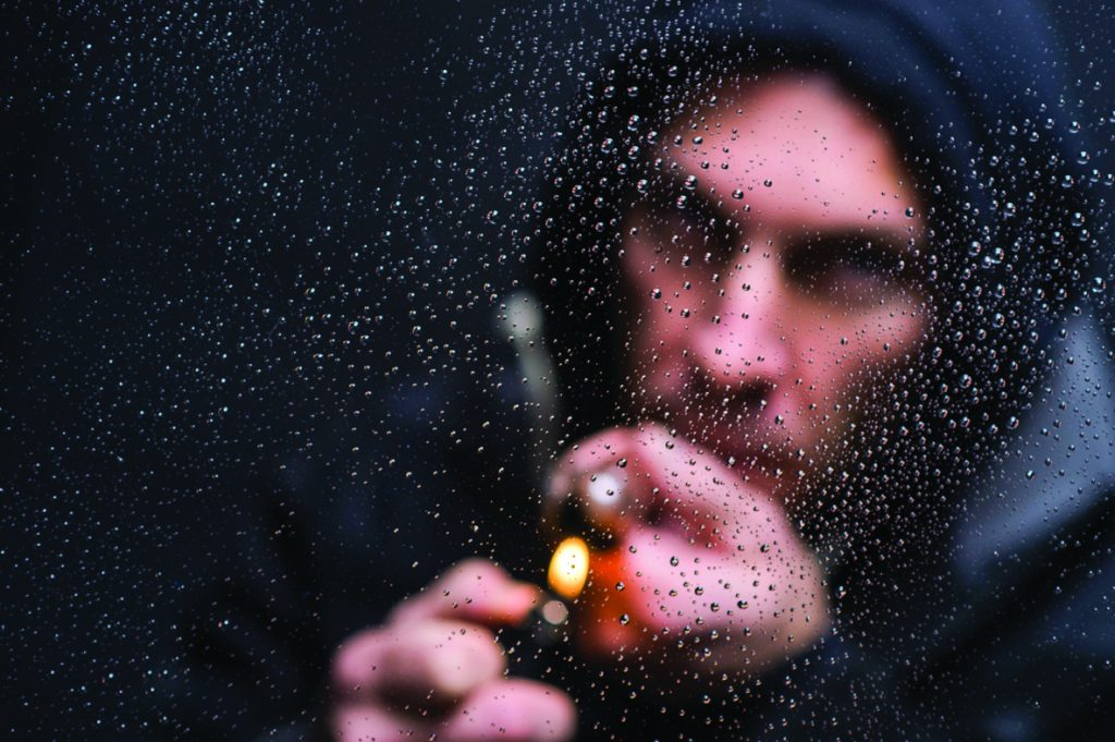 Drug Addiction photo illustration of model smoking a crack pipe.