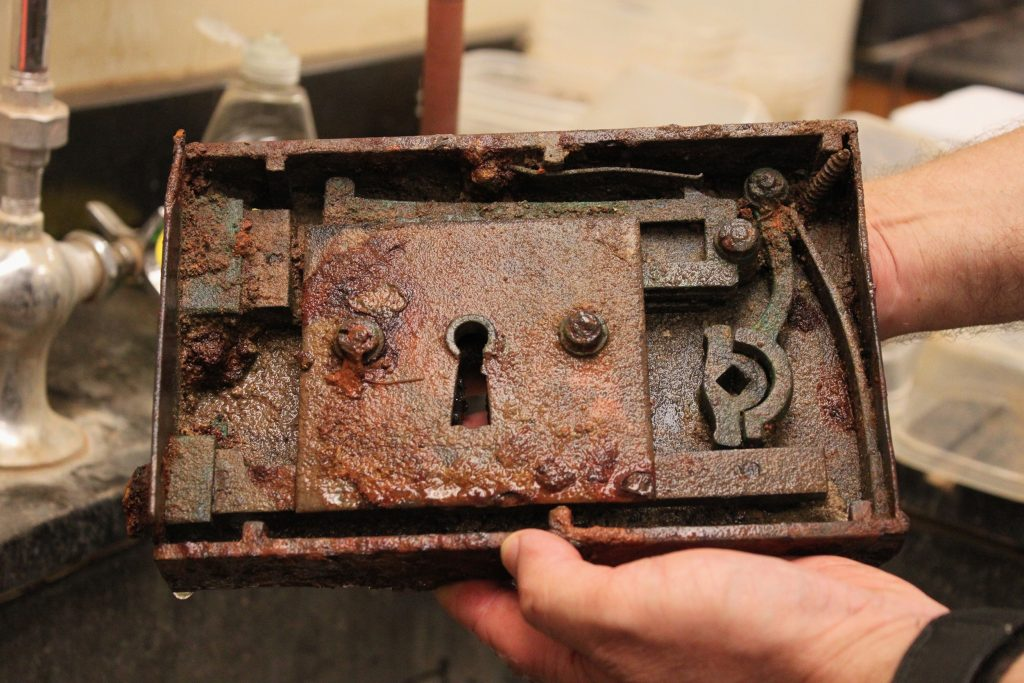 An old and rusted lock mechanism from President Caldwell's front door.