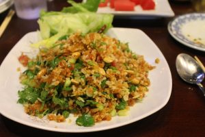 Nam khao is one of the most popular dishes at Asian Fusion Kitchen in Morganton, N.C. It combines dry stick rice with seasoned rice, fermented pork and seasonings. (photo courtesy of Katy Clune)
