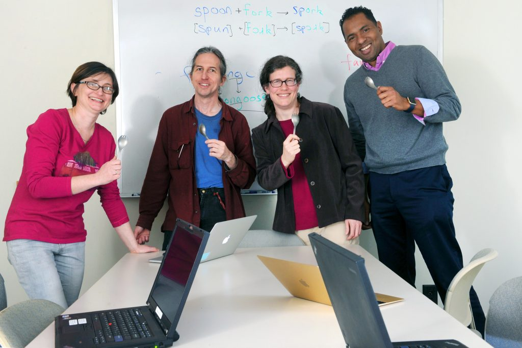 "From left, linguists Katya Pertsova, Elliott Moreton and Jennifer Smith and computer scientist Fabian Monrose are exploring using lexical blends like the word ""spork"" to create attack-resistant passwords. They're holding titanium sporks (both flexible and strong) as a symbol of their partnership. (photo by Donn Young)"