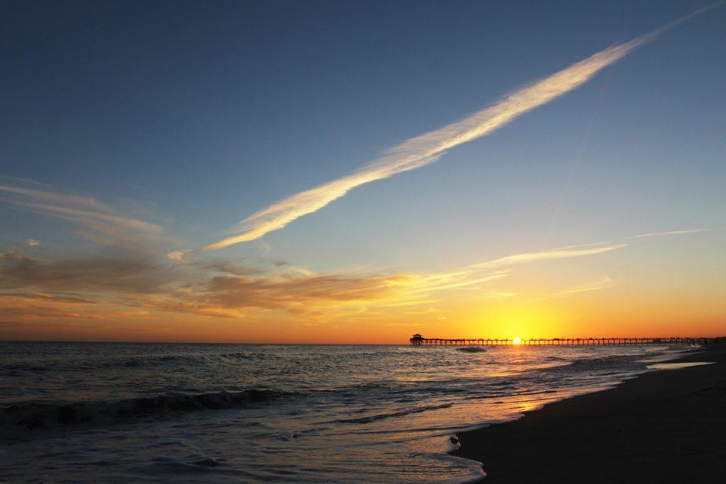 Sunset over a pier