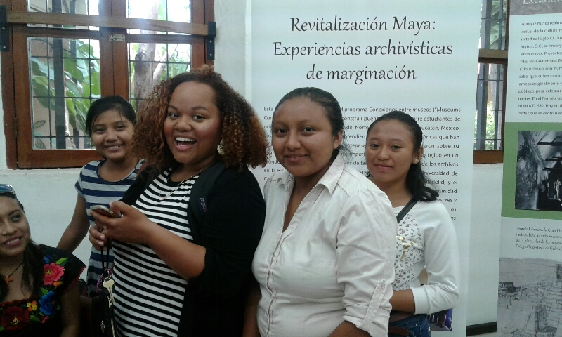 Museums Connect mentor Raina Enrique (senior at UNC-Chapel Hill) with students from the Universidad de Oriente de Yucatan at the opening of their exhibit at the State Archives of Yucatan. (photo courtesy of Gabrielle Vail)
