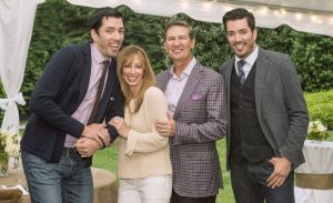 """Lowe and wife, Julia, with Jonathan and Drew Scott, hosts of """"Property Brothers,"""" at an auction to benefit the American Heart Association."""