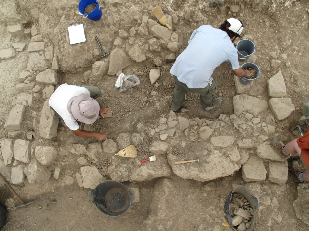 For 16 years, UNC researchers and students have led a large international archaeological team at Azoria, on the island of Crete. In this photo, you see an overhead view of people digging on the Azoria site.
