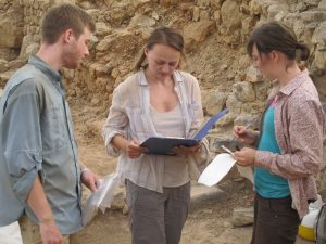 UNC classical archaeology Ph.D. student Cicek Beeby (center) works with trench assistants Zachary Lingle (chemistry, minor in archaeology '15) and Mallory Melton (anthropology, archaeology '14.