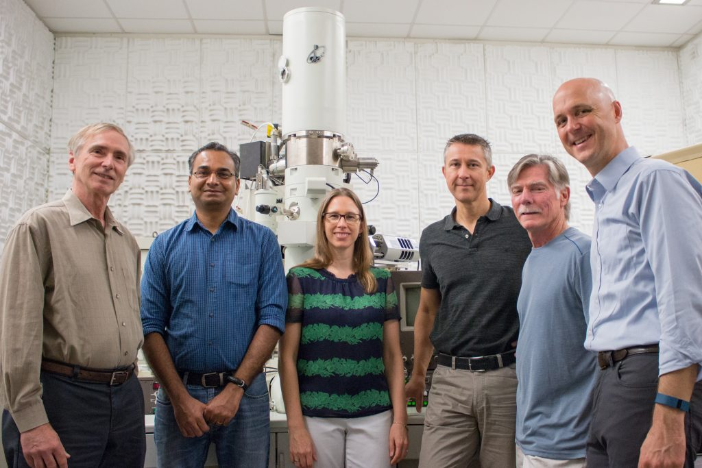 Staff members Wallace Ambrose, Amar S. Kumbhar and Carrie Donley and professors Theo Dingemans, Greg Forest and Peter Mucha stand in front of equipment in the Chapel Hill Analytical and Nanofabrication Laboratory, also known by the acronym, CHANL..