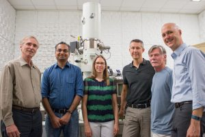 Staff members Wallace Ambrose, Amar S. Kumbhar and Carrie Donley support the nanocomposites research of professors Theo Dingemans, Greg Forest and Peter Mucha —producing high-resolution images of carbon nanotubes embedded in crystalline polymer. They stand in front of equipment in the Chapel Hill Analytical and Nanofabrication Laboratory.