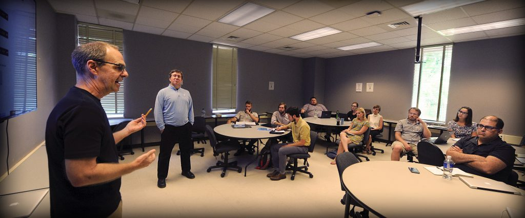 Dan Anderson, left, director of UNC's Digital Innovation Lab, and Todd Taylor, director of the Writing Program, teach a hands-on workshop for English 105 instructors at the start of the fall semester. The session focused on how to design digital class projects.
