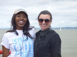 Tiana Petree, left, shown with classmate Anna Baker, learned how much work goes into running a nonprofit. She waits with another student for the San Francisco Bay Cruise.