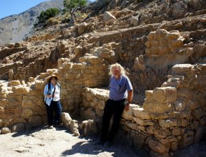Professors Margaret Scarry and Donald Haggis take a break in an archaic (6th c. B.C.) storeroom of the West Building at Azoria.
