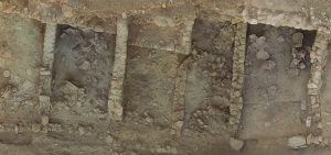 An aerial view of the storerooms of the West Building at Azoria shows deposits of storage vessels.