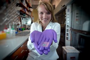 Former Ph.D. student Katie Moga holds an adhesive patch embedded with microneedles which was deisgned to deliver medication painlessly. This is an example of multidisciplinary research known as convergent science.