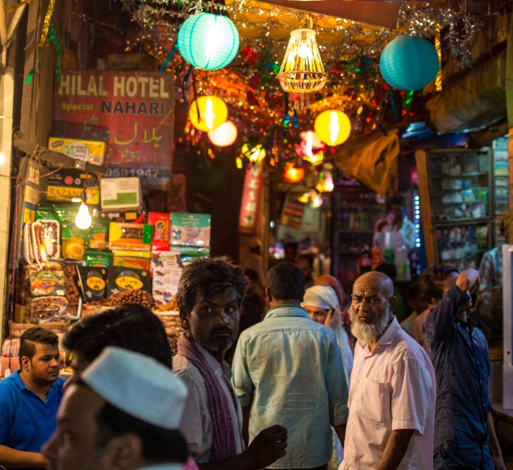 Vendors and shoppers at a night market behind the Jama Masjid mosque in Delhi, India.