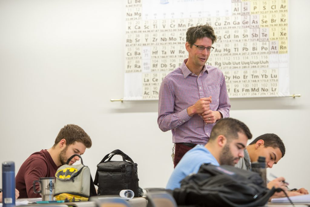 "Chemistry department chair Jeffrey Johnson teaches graduate students in ""Synthetic Organic Chemistry."" As the department celebrates its 200th birthday, he says ""this is a pivotal time for Carolina chemistry."" (photo by Steve Exum)"