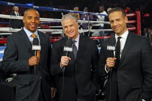 Andre Ward, Jim Lampley and Max Kellerman commentate on the side of the ring at the HBO World Championship Boxing card.