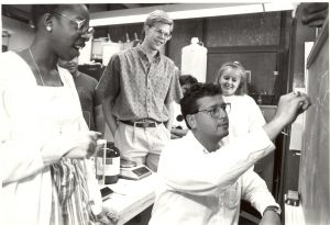 Joseph DeSimone (right) with his first doctoral student, Valerie Ashby (far left), around 1990. DeSimone is one of Carolina's most accomplished professors and entrepreneurs. Ashby is now dean of Duke University's Trinity College of Arts & Sciences. (photo courtesy of N.C. Collection, University Libraries)