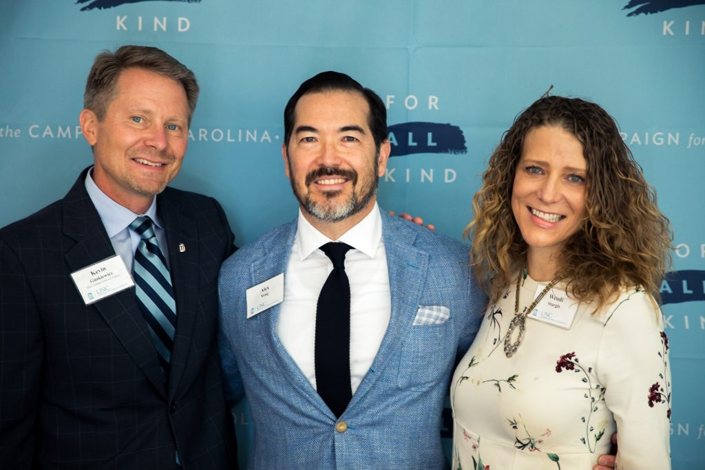 Dean Kevin Guskiewicz (left) celebrated Alex Yong and Wendi Sturgis' gift at Carolina's For All Kind campaign kickoff in October. The couple's support benefits scholarships, the Learning and Writing Center and diversity initiatives in the department of computer science. (photo by Jafar Fallahi)