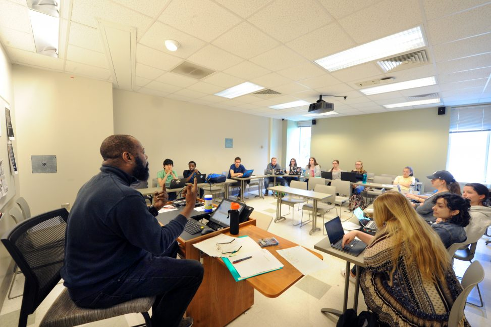 Randall Kenan, shown here teaching one of his creative writing classes, will be inducted into the North Carolina Literary Hall of Fame in October. (photo by Donn Young)