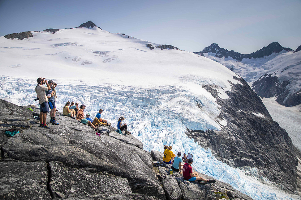 Students receive an outdoor lecture at Camp 18 at the Juneau Icefield