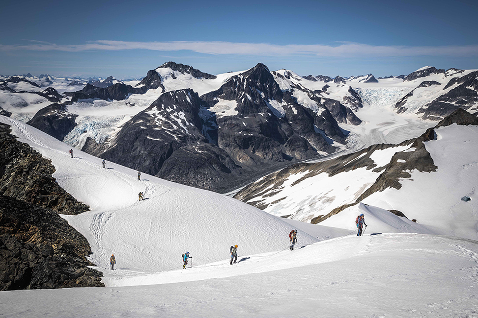 Students hike in a rope team up a peak named 'Sunstorm' on the Juneau Icefield