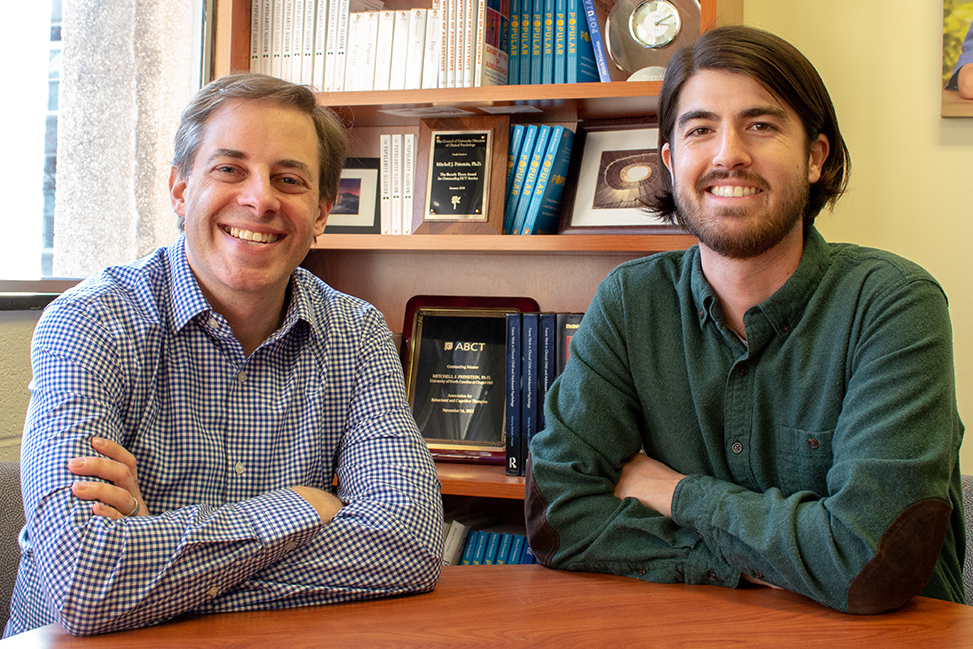 Graduate student Matthew Clayton (right) and his adviser, Mitch Prinstein, conduct studies focused on teen depression. (photo by Kristen Chavez)