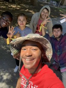 Kwaji Bullock takes a selfie with other Cumpston Fellows during their border trip.