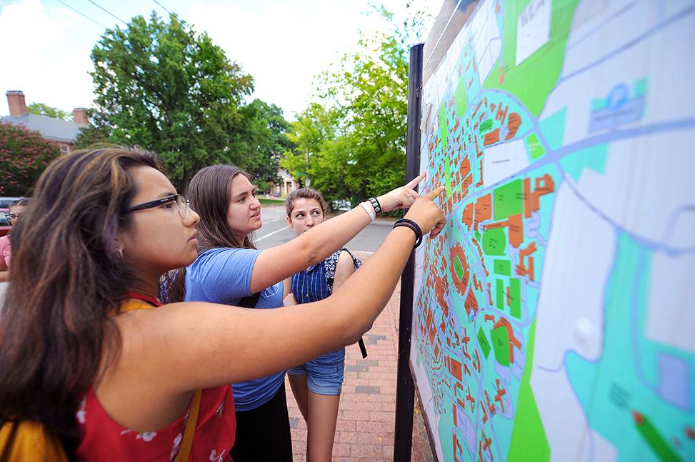 Lookout Scholars Briyete Garcia-Diaz, Sara Coello and Hannah Thompson examine a campus map during an orientation scavenger hunt.