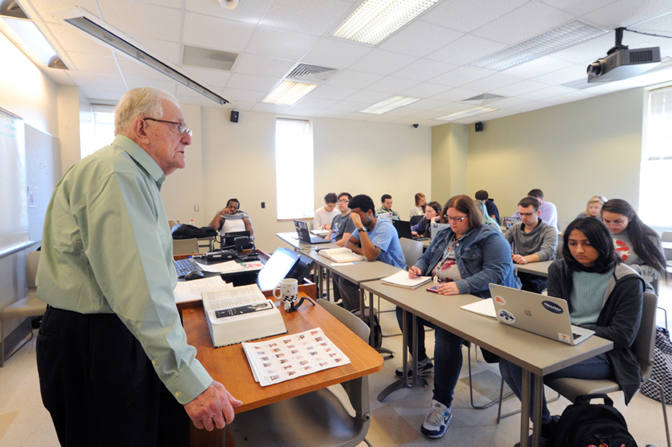 """Professor Christopher Armitage taught his Shakespeare class in Greenlaw Hall for the last time in fall 2019. He calls Shakespeare """"a supreme master of language"""" with a flair for telling a good story. He is shown here teaching a class."""