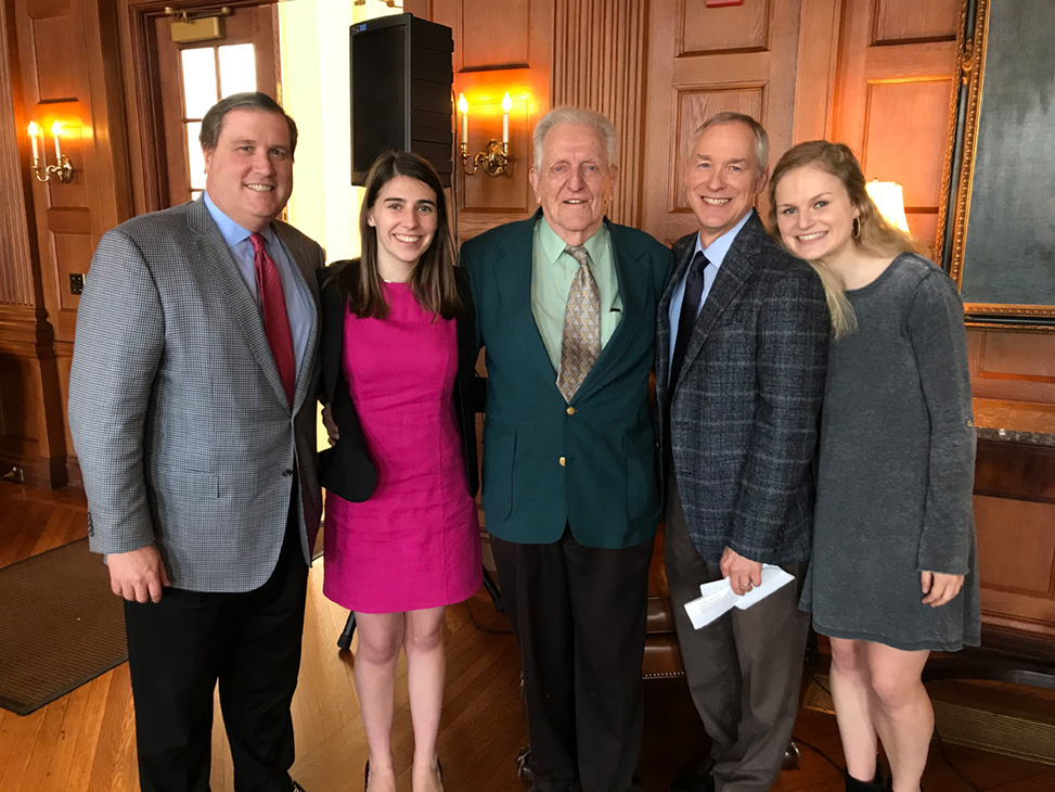 From left to right, fathers and daughters who studied at Oxford with Armitage (center): Tom Lutz '87, Charlotte Lutz '21, Laine Kenan '87 and Claire Kenan '21 at a recent celebration announcing the Christopher Armitage Student Travel Scholarship.