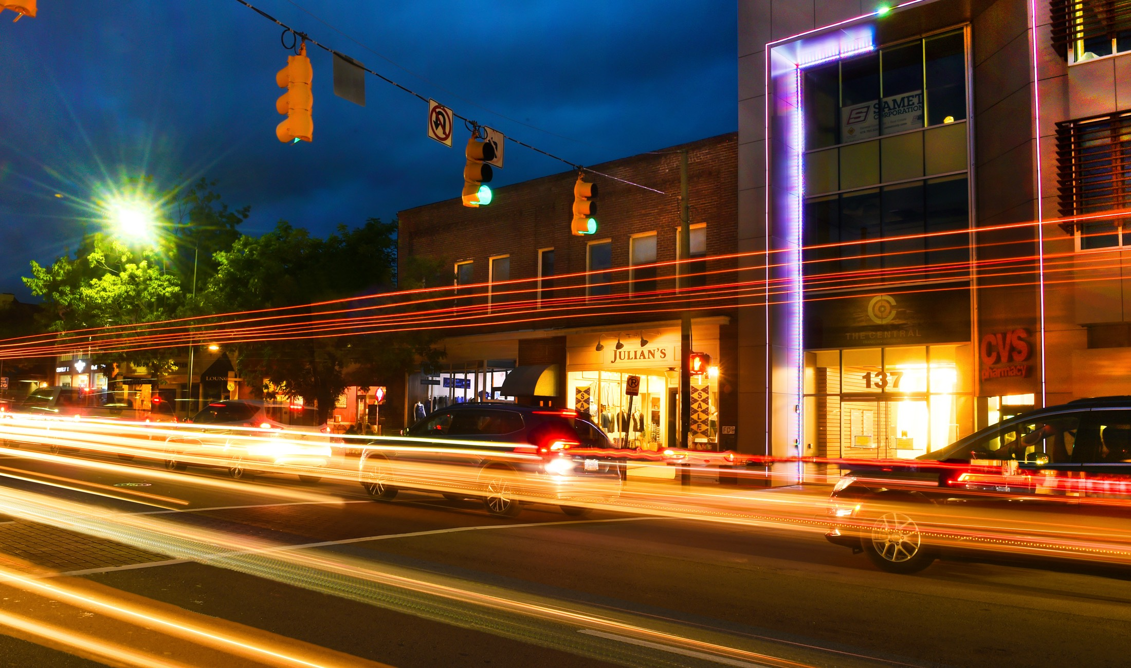 A long-exposure view of East Franklin Street in downtown Chapel Hill on a cloudy evening.