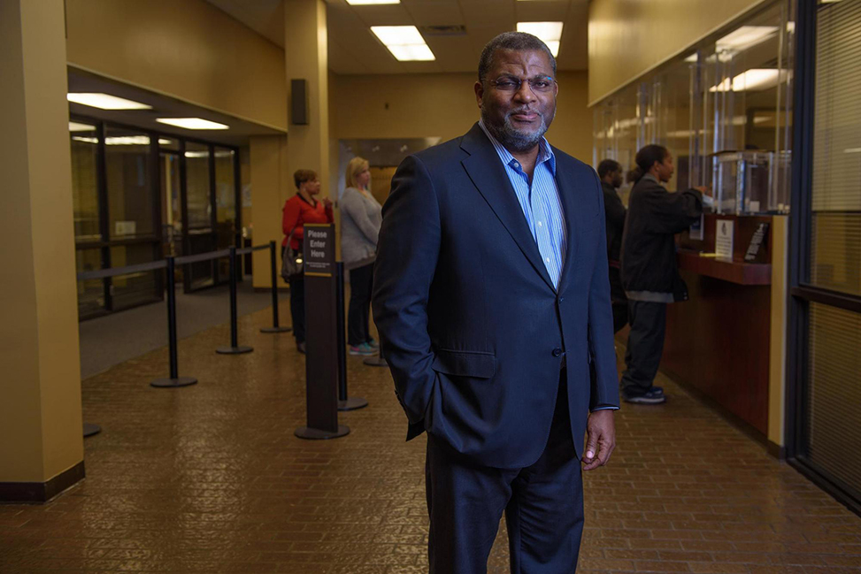 Bill Bynum stands in a hallway at a Hope Credit Union branch.
