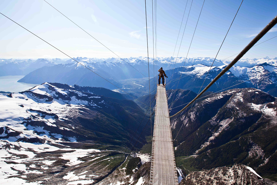 Pablo Durana on a bridge high above Mount Bute in British Columbia