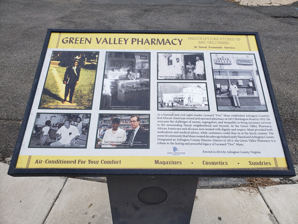 Historical marker of 'Green Valley Pharmacy' in the historically Black community in Arlington, Virginia.