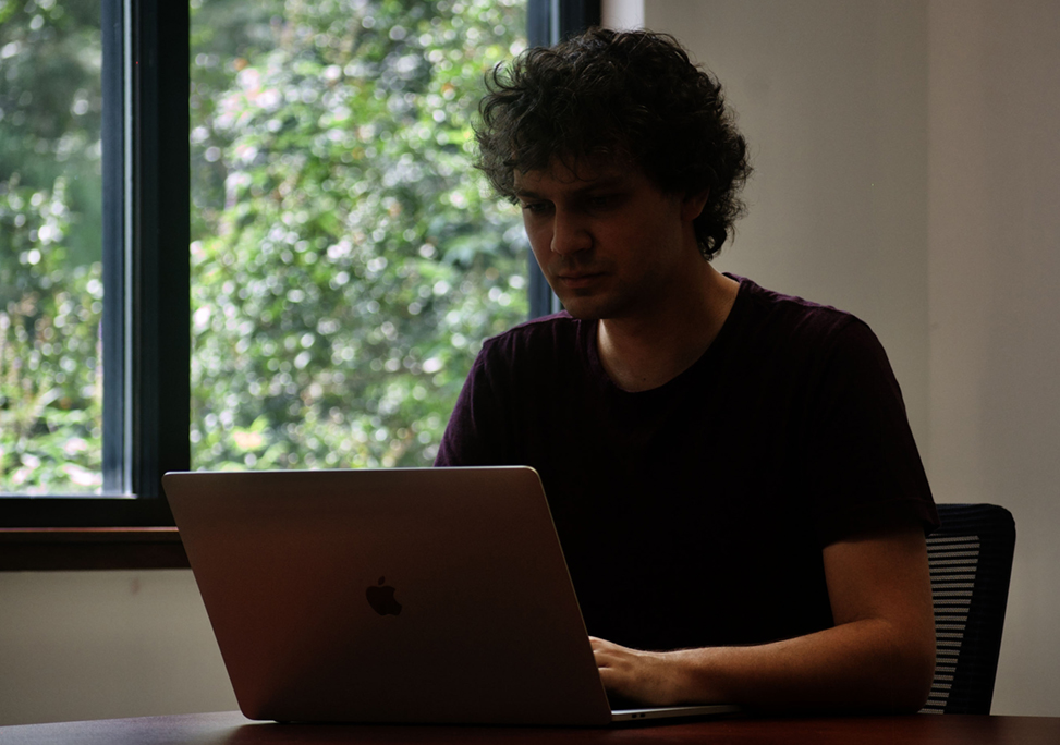 Joe Puccio at his laptop.