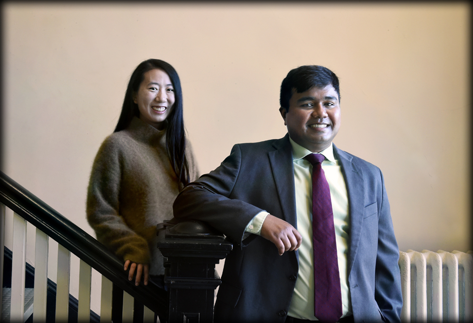 Jiayi Bao and Abhisekh Ghosh Moulick at a staircase in Abernethy Hall.