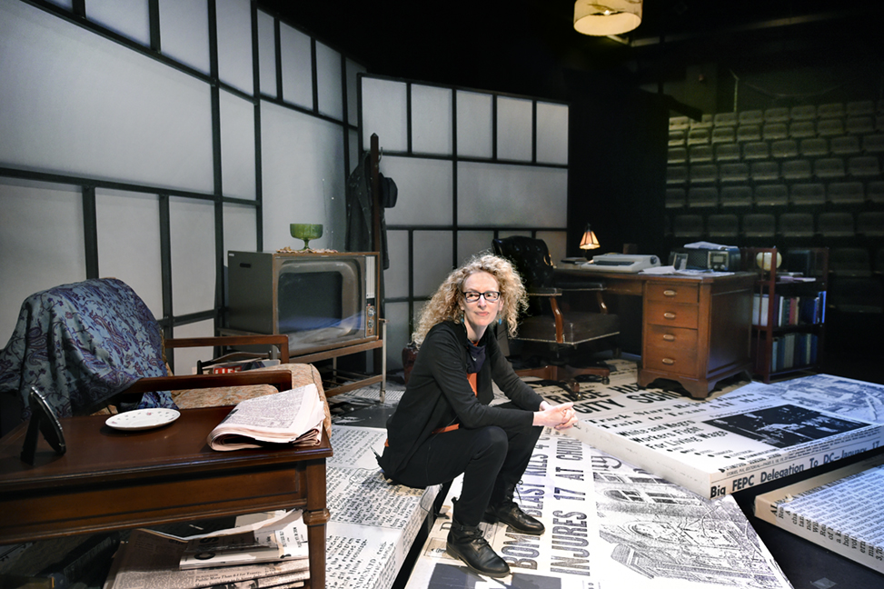 Vivienne Benesch sits on the Paul Green Theatre stage, which is designed for