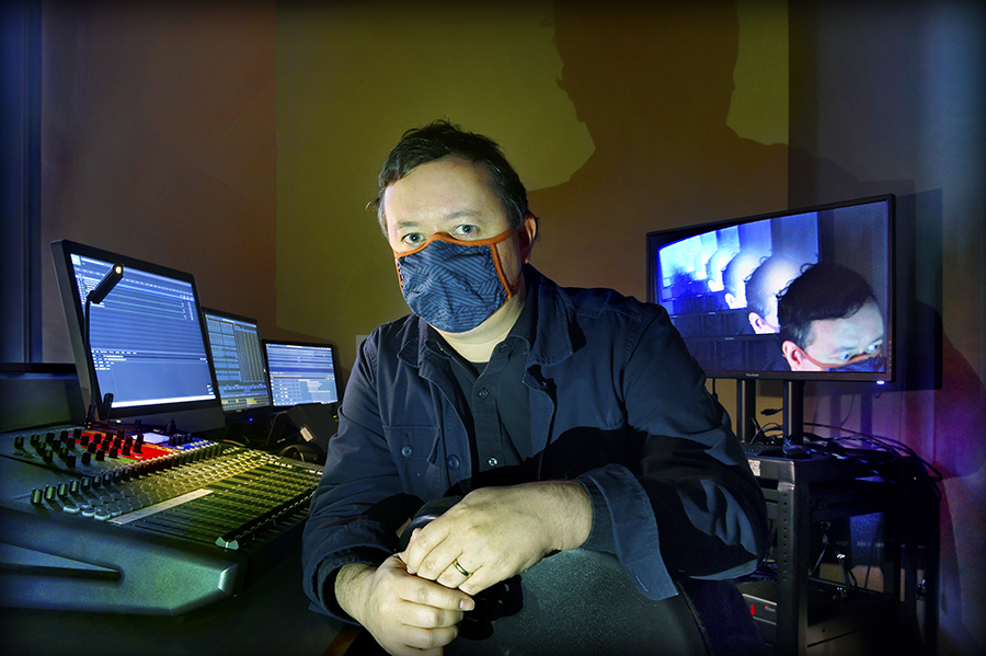 Jesse Alan Moorefield pictured with a mask on in a control booth